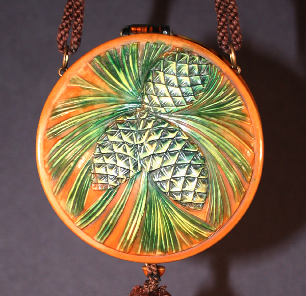 Pinecones celluloid purse